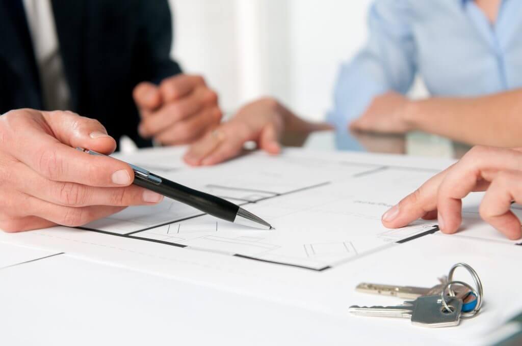 tenants reviewing property blueprints