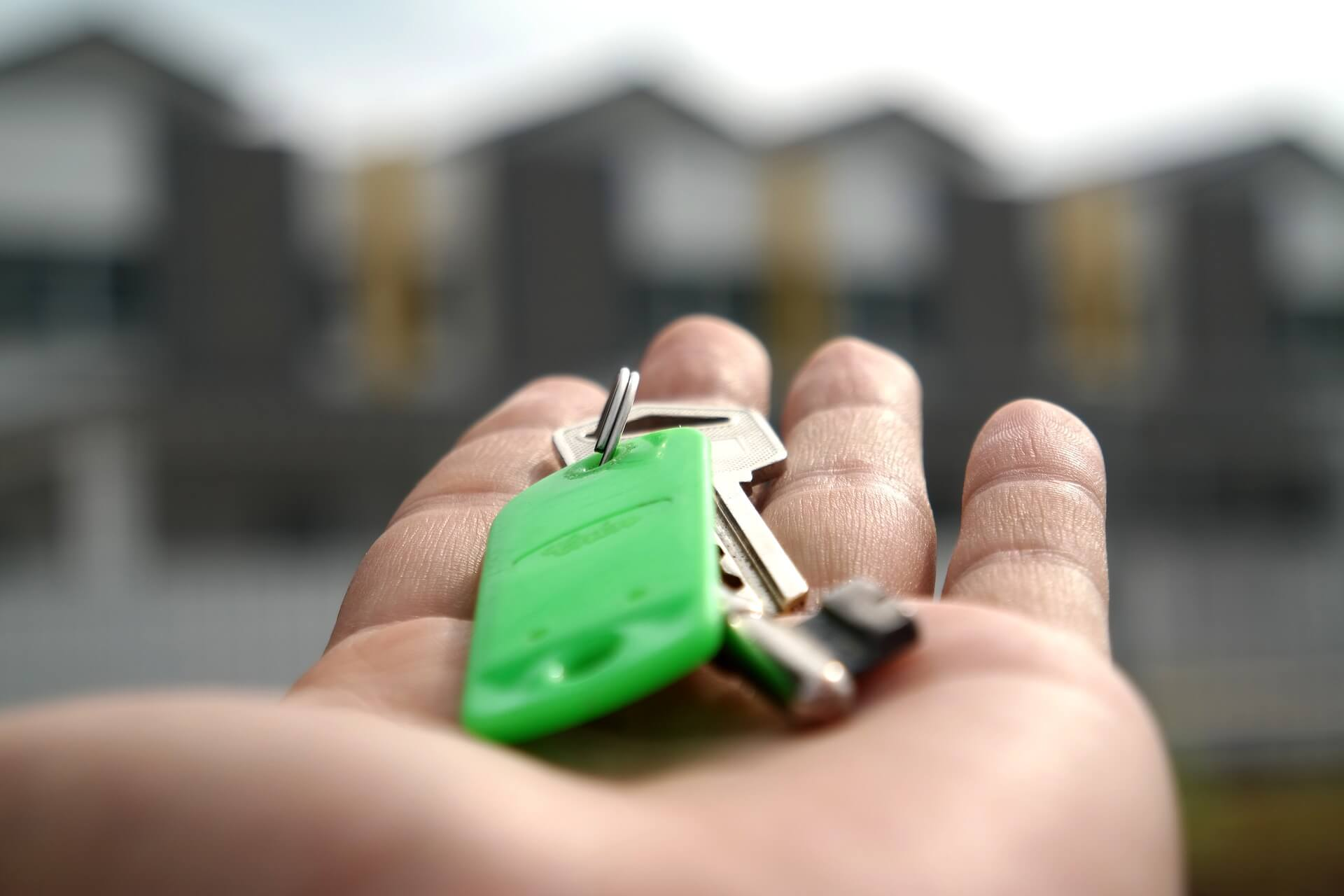 perspective of palm holding set of house keys