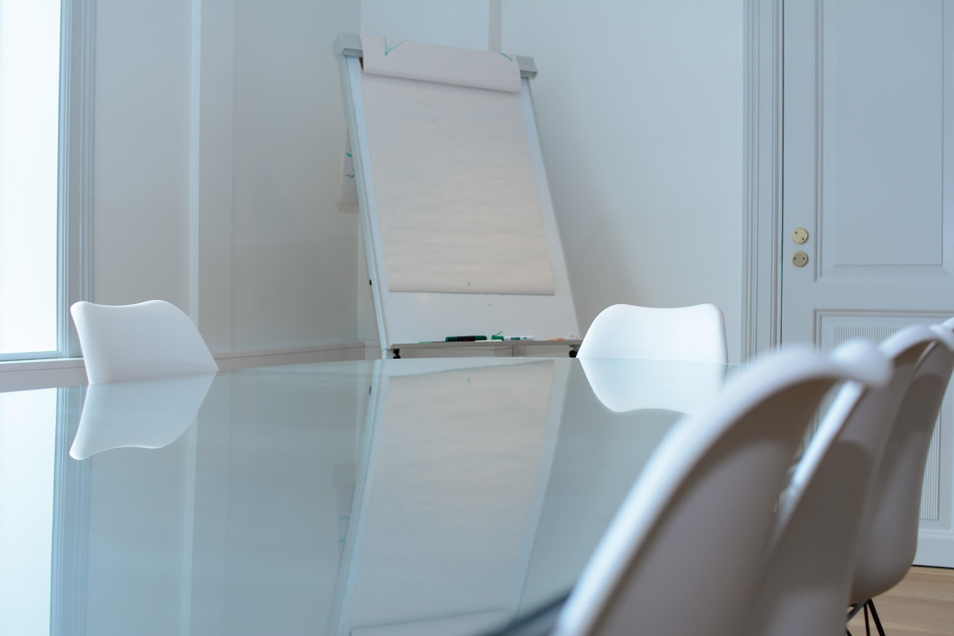 meeting table with chairs and large notepad