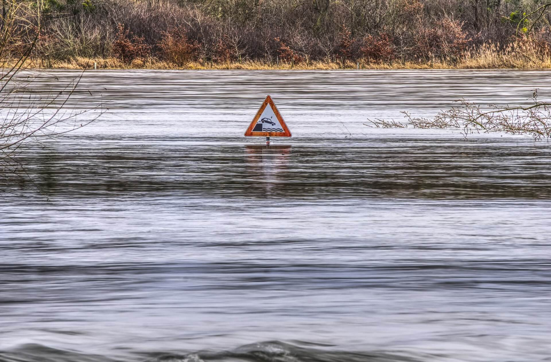 flood nearly covering street sign